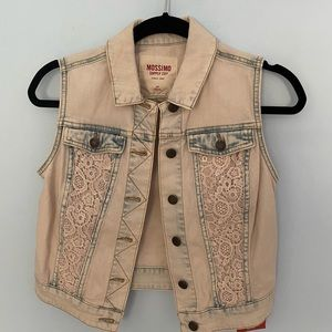 Cropped, light wash, denim vest with lace accents